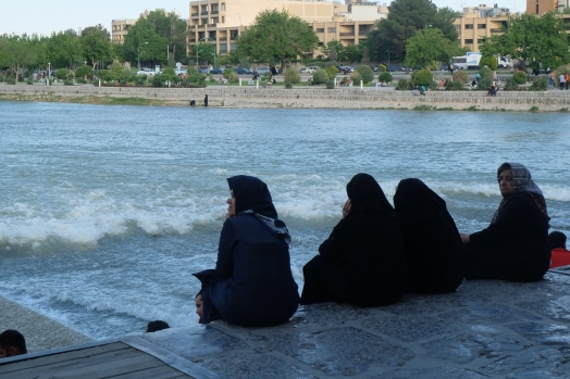 Sitting on the Khaju Bridge, Isfahan, Iran